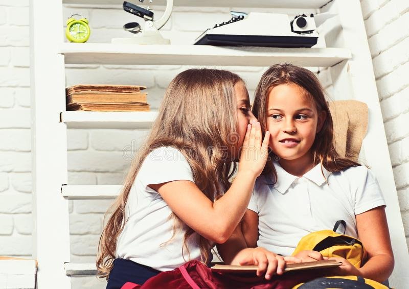 Elementary school girls reading a book in class. Elementary school girls reading a book in class stock image