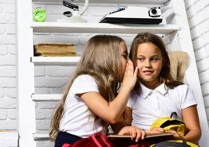 Elementary school girls reading a book in class. stock photography