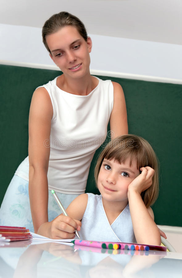 Download Elementary School Pupil  And Teacher Stock Image - Image of pencil, learn: 17926999