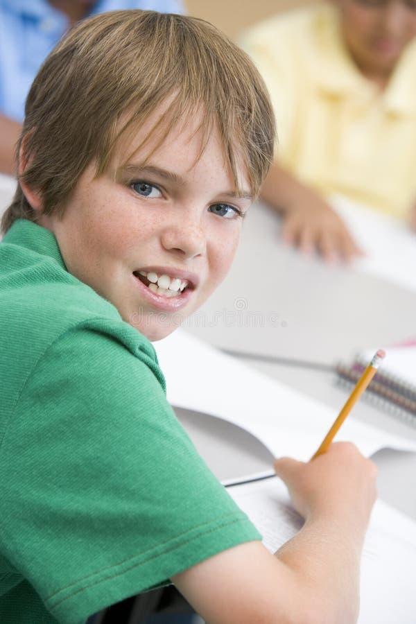 Elementary school pupil writing stock image