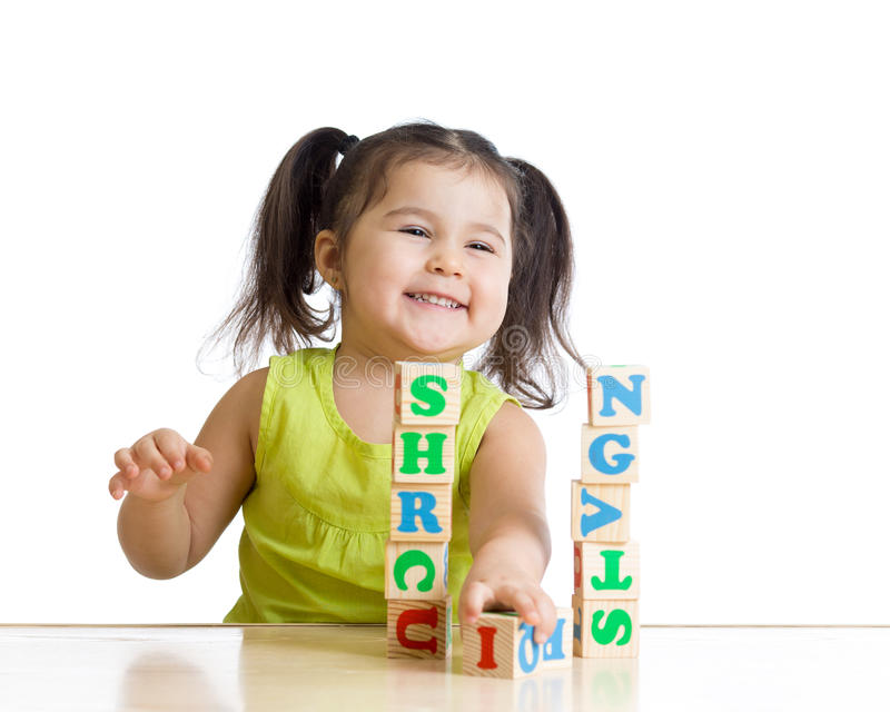 Elementary school student playing letter blocks royalty free stock photos