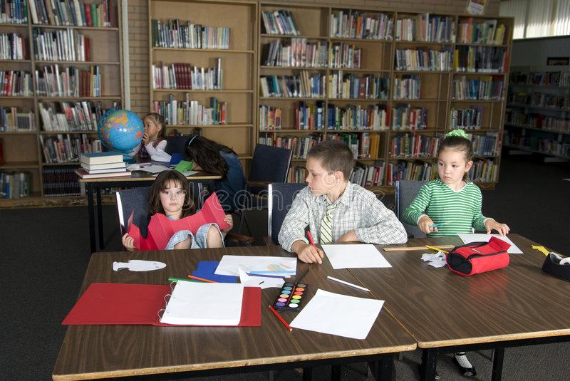 Elementary school students studying stock photography