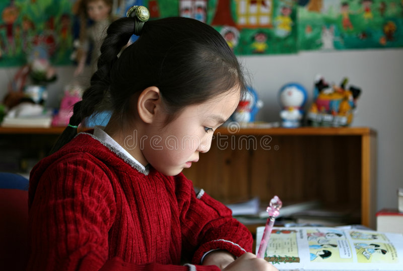 Elementary student doing english homework stock photo