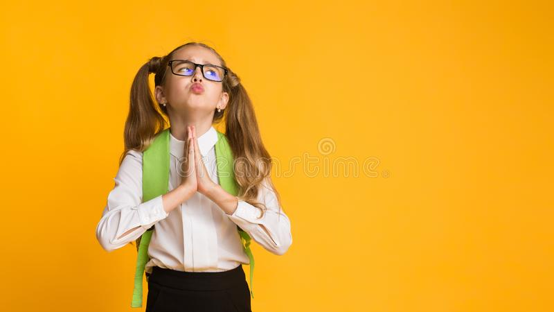 Elementary Student Girl Asking For Something Praying In Studio royalty free stock photography
