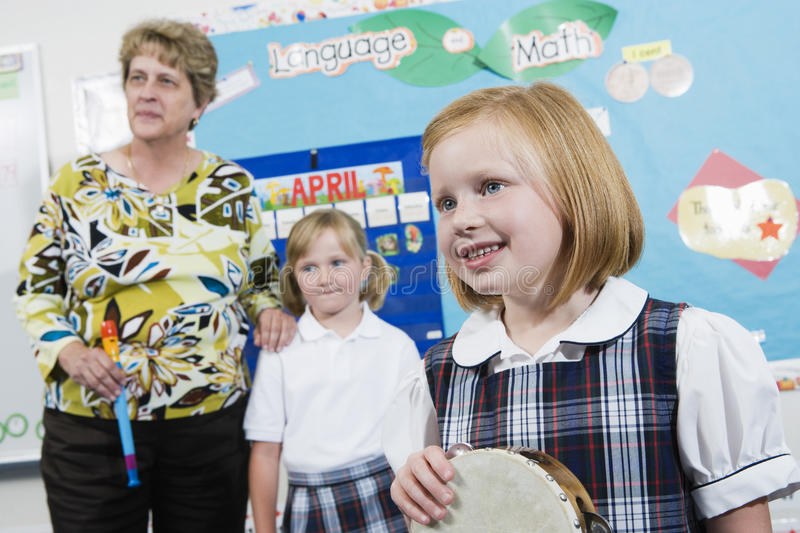 Elementary Student With Tambourine In Music Class royalty free stock images