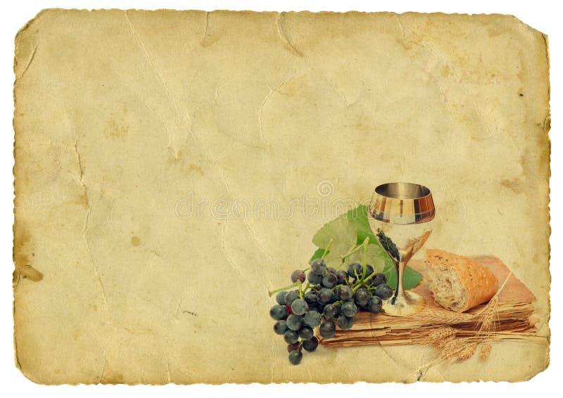 Elemente der heiligen Kommunion auf altem Papierhintergrund lizenzfreies stockfoto