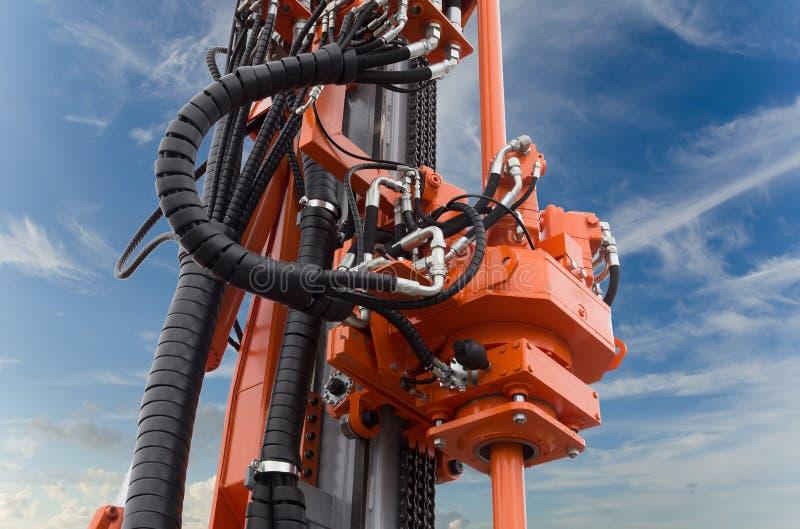 Elementen van de hydraulische boormachine voor rupsbanden stock foto