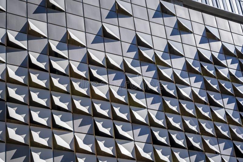 Elementi curvi della decorazione di costruzione a più piani moderna fotografia stock libera da diritti