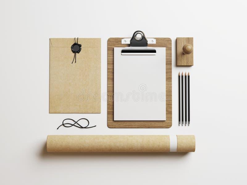 Elementi della cancelleria sul fondo del Libro Bianco fotografie stock libere da diritti
