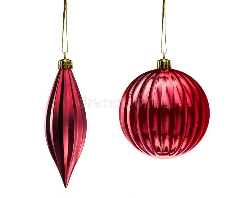 Elementi rossi della decorazione di Natale isolati su fondo bianco fotografia stock
