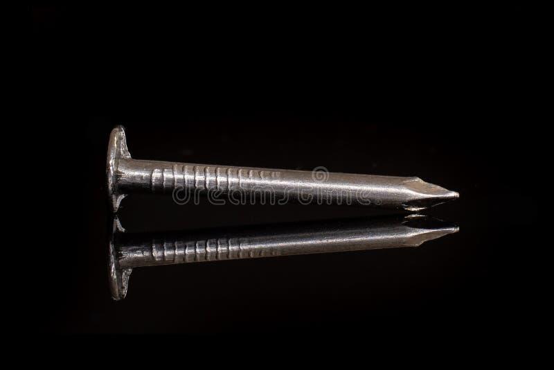 Elemento dello strumento del lavoro isolato su vetro nero fotografia stock