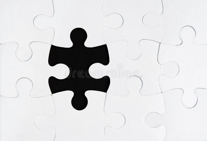 Elemento faltante de um enigma foto de stock