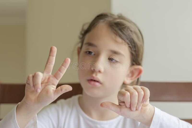 The elementry student is making herself homework royalty free stock photos