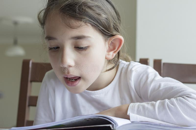 Elementry student reading your homework stock photography