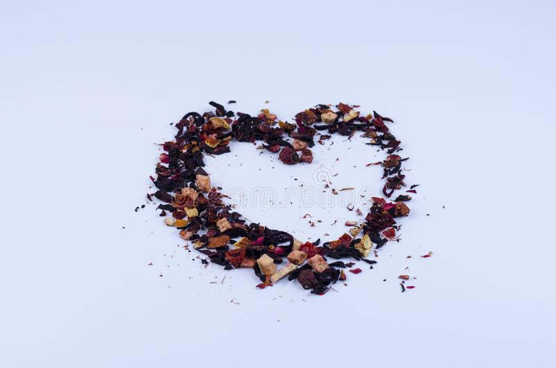 Elements of fruit tea laid out in the shape of a heart royalty free stock photography