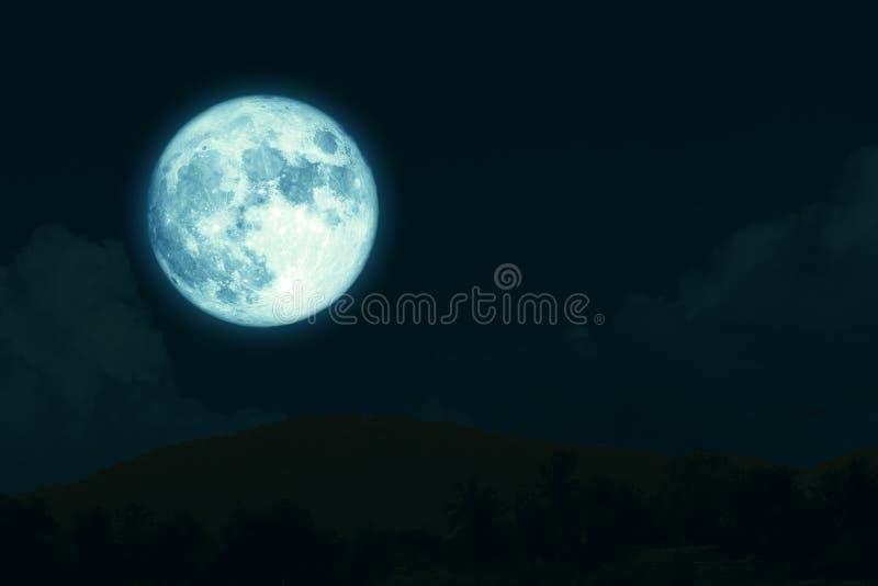 super full harvest moon on night sky back silhouette mountain stock photos