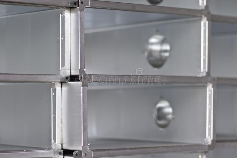 Elements and parts made of galvanized sheet for various ventilation systems. Russia stock images