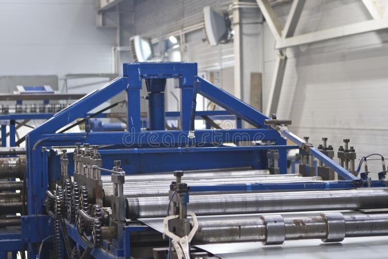 Elements of various sections of the galvanized steel processing line in rolls. Manufacturing royalty free stock photos