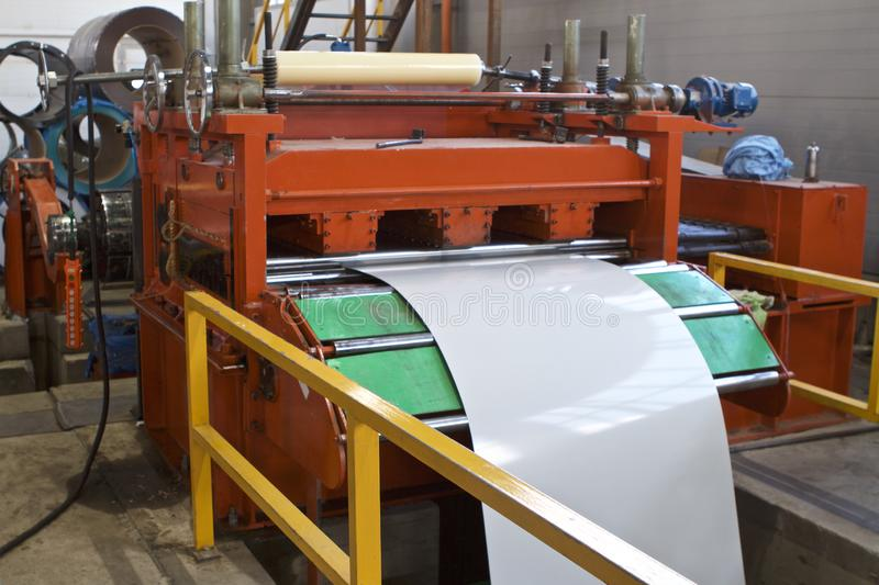 Elements of various sections of the galvanized steel processing line in rolls. Manufacturing stock photos