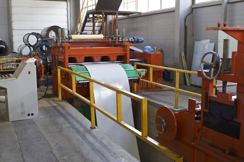 Elements of various sections of the galvanized steel processing line in rolls. Manufacturing stock images