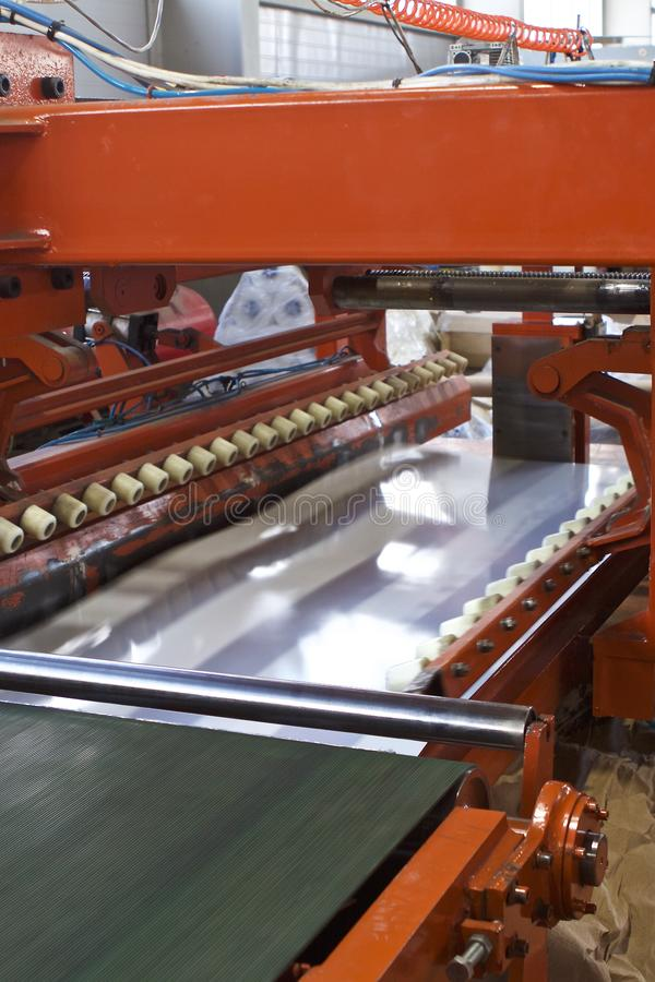 Elements of various sections of the galvanized steel processing line in rolls. Manufacturing stock photography