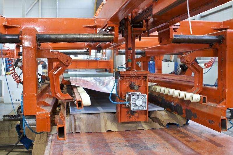 Elements of various sections of the galvanized steel processing line in rolls. Manufacturing stock photo