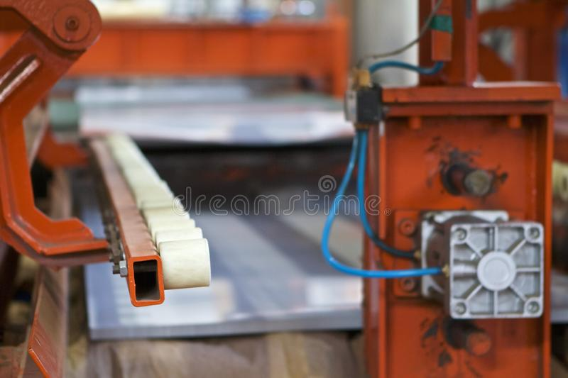 Elements of various sections of the galvanized steel processing line in rolls. Manufacturing stock image