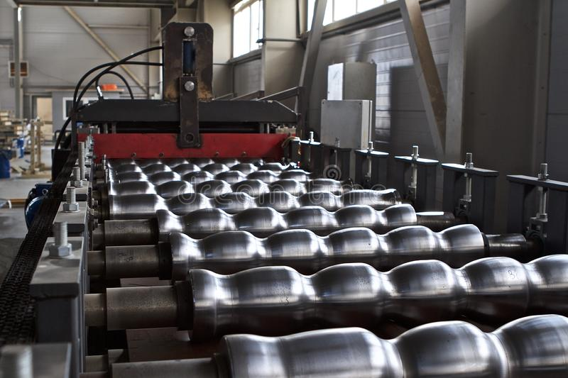 Elements of various sections of the galvanized steel processing line in rolls. Manufacturing royalty free stock image