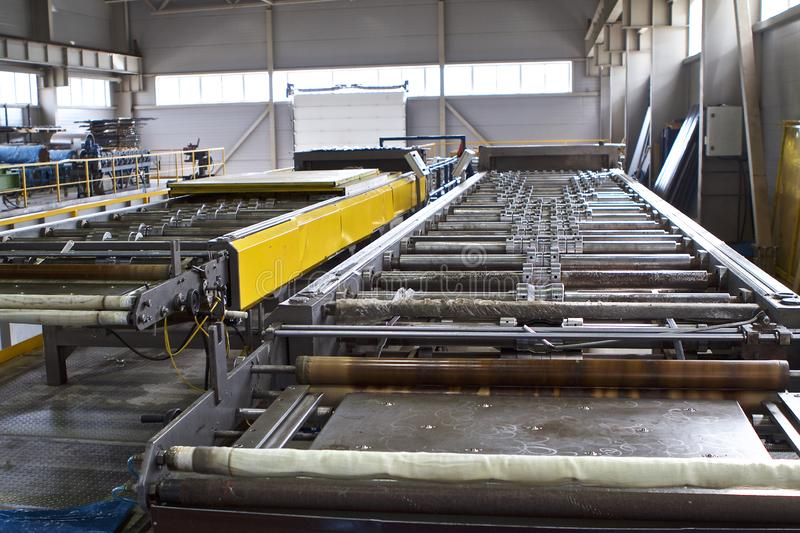 Elements of various sections of the galvanized steel processing line in rolls. Manufacturing royalty free stock images