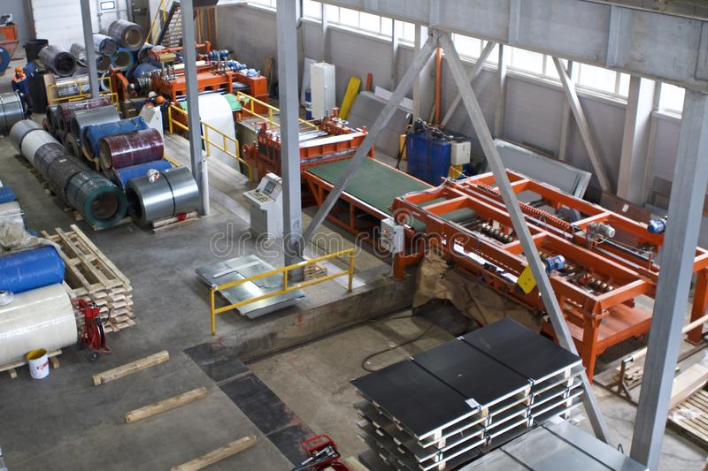 Elements of various sections of the galvanized steel processing line in rolls. Manufacturing royalty free stock photography