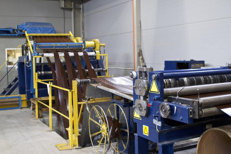 Elements of various sections of the galvanized steel processing line in rolls. Manufacturing royalty free stock photo