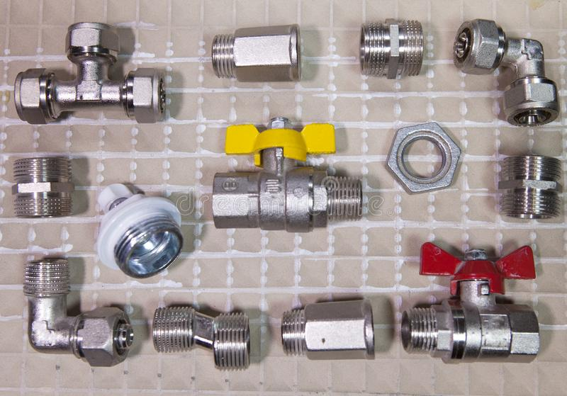 Elements of water and gas shutoff valves, flat lay.  stock photo