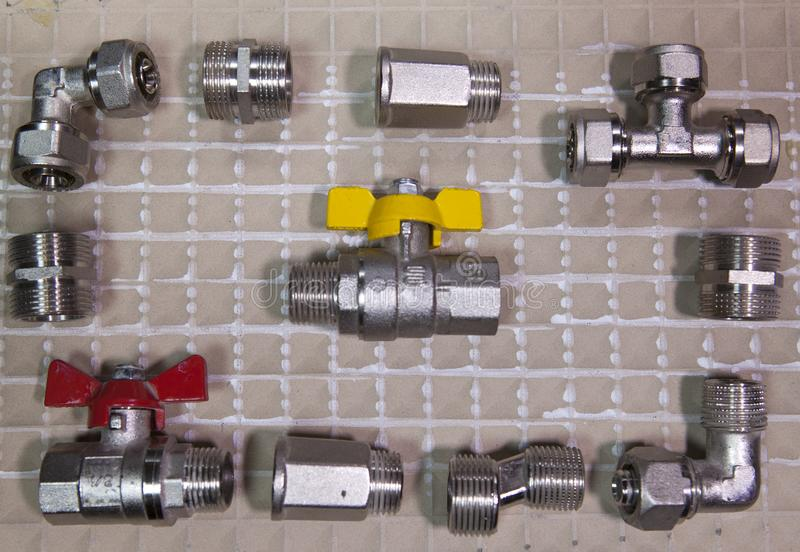Elements of water and gas shutoff valves, flat lay.  stock images