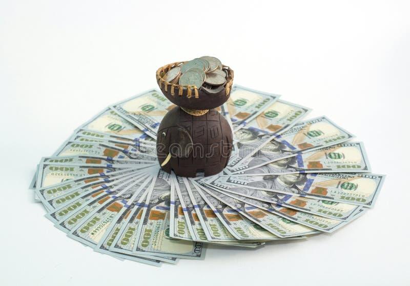 Elephant on the dollars. Hundred dollar bills. Money for travel and rest stock photo