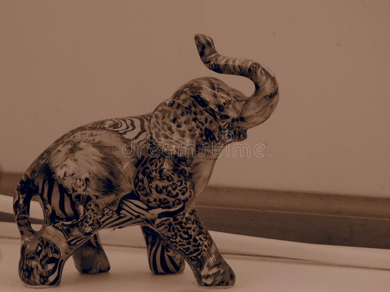 Elephant Figurine with Sepia filter stock image