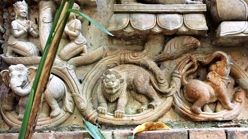 Elephant Lion demon mould terracotta. Demon intimidate Lion two elephants ivy mold Sculpture terracotta ancient story stock photography