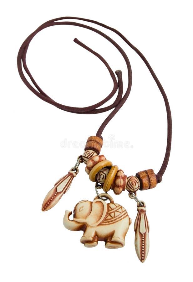 Elephant pendant on lace isolated on white royalty free stock image