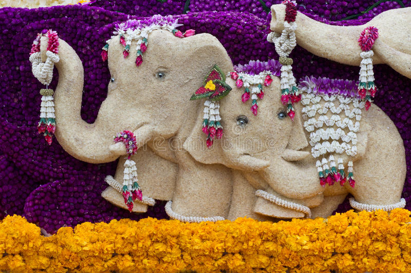 Elephant statue decorated with flowers. stock photos