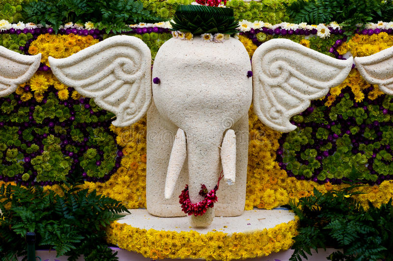 Elephant statue decorated with flowers. stock photography