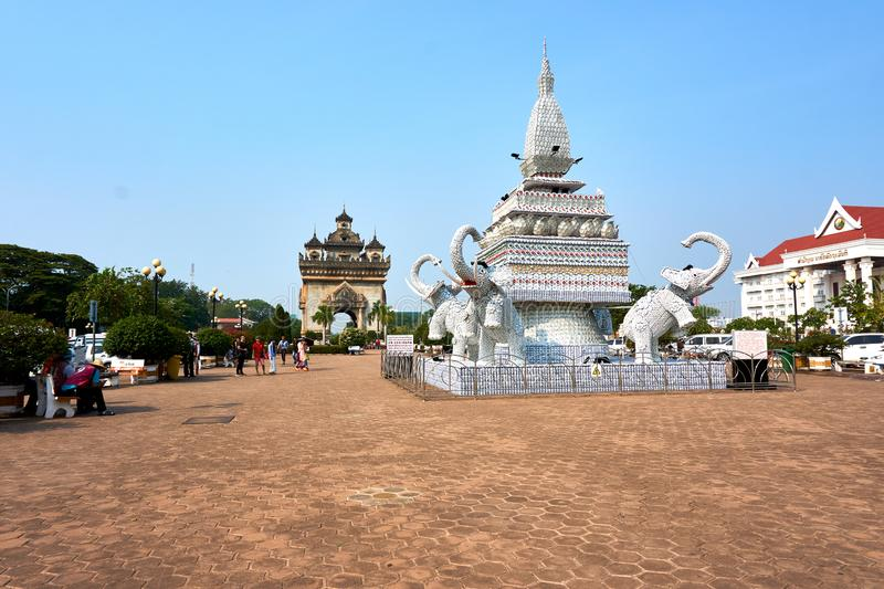 Elephant statue out of cups and plates next to Patuxai Victory Monument The One Attractive Landmark of Vientiane City of Laos royalty free stock image