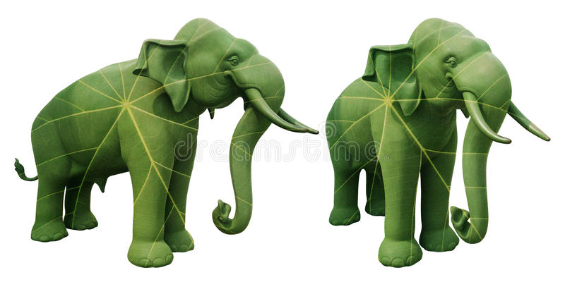 Elephant statue overlaid with green leaf. Represent environment concept isolated on white royalty free stock photo
