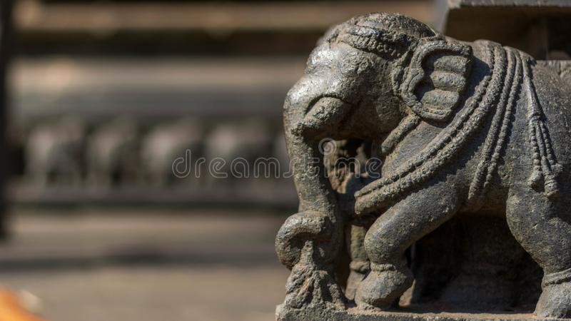 Elephant statue - partly ruined. Small elephant statue - forming the foundation or the base of the hoysala architecture temples royalty free stock images