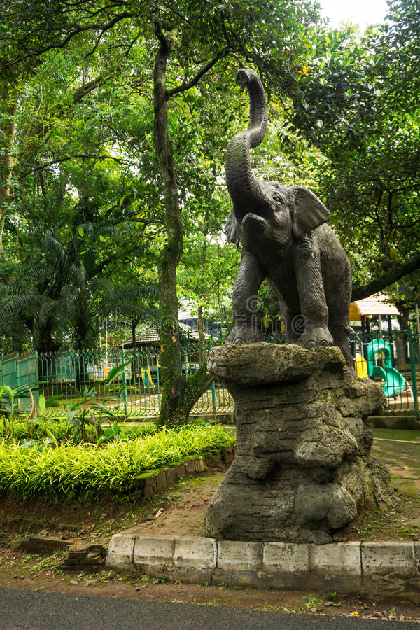 Elephant statue standing on rock in front of children playground photo taken in Ragunan zoo Jakarta Indonesia. Java stock photos