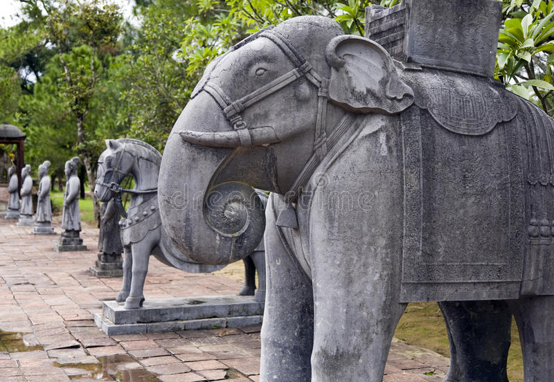 Elephant Statues at Minh Mang Tombs. Ancient statues carved from stone stand in front of the entrance to Minh Mang Tomb near Hue in Vietnam stock photography