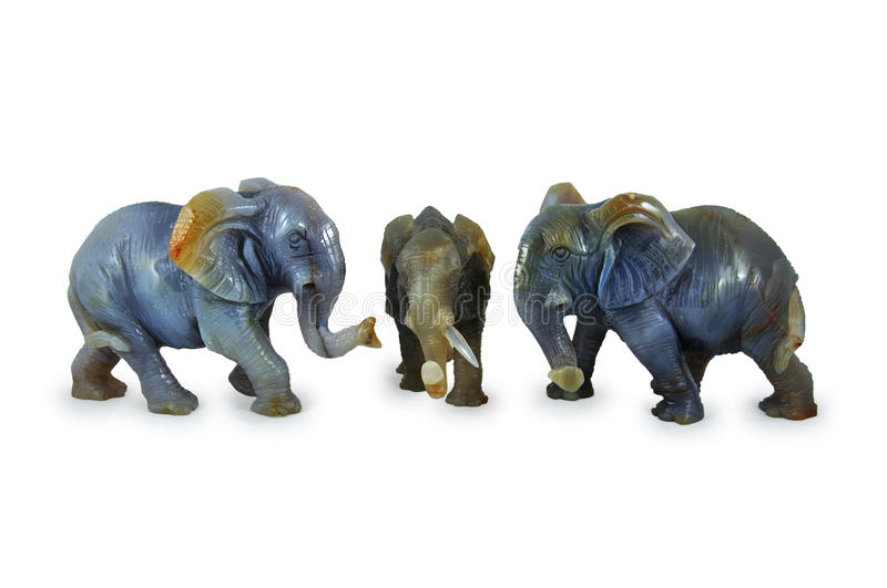 Elephants from agate. Figures of elephants from agate on a white background stock photography