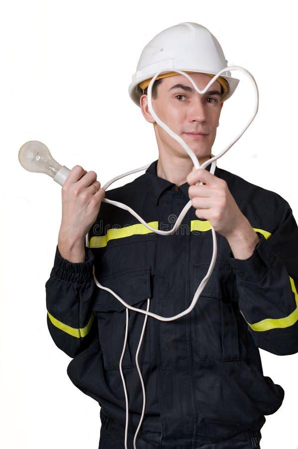 Eletricista com calor e lâmpada imagem de stock royalty free