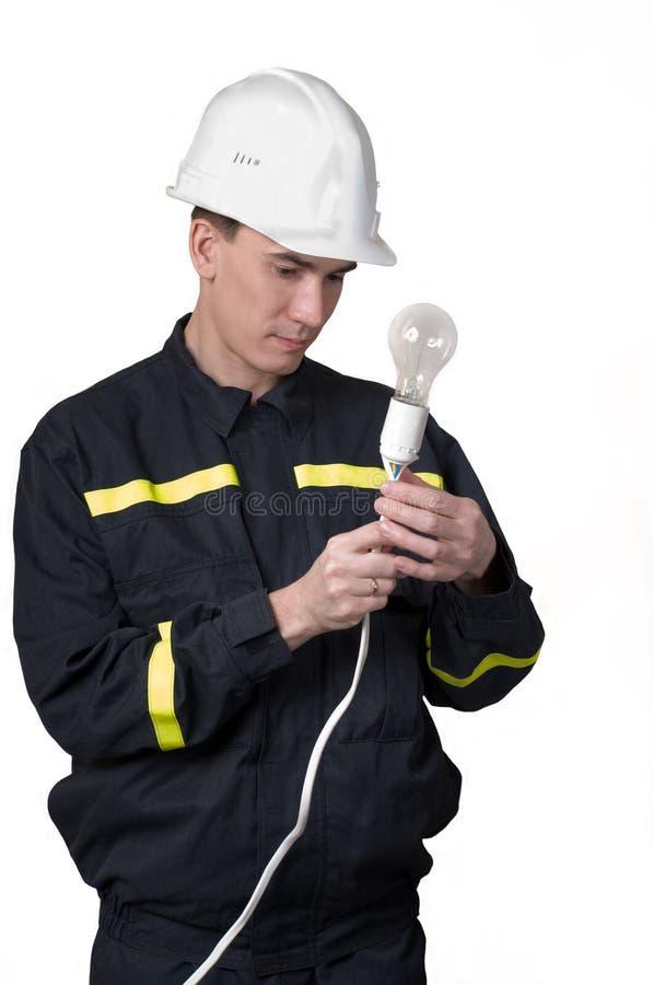 Eletricista com lâmpada fotografia de stock royalty free