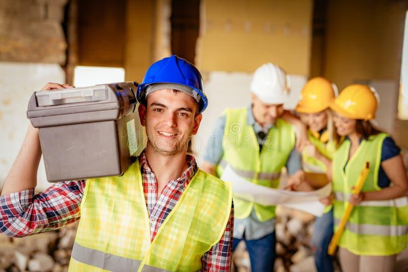Elettricista At Construction Site fotografia stock