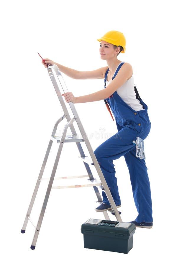 Elettricista della giovane donna in abiti da lavoro con la cassetta portautensili, cacciavite immagine stock libera da diritti