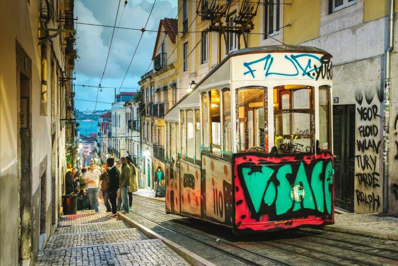 Elevador da Bica - Lisbon, Portugal. Lisbon, Portugal - May 10, 2017 :The Elevador da Bica is a funicular linking Rua de São Paulo with Rua de Loreto in the stock images